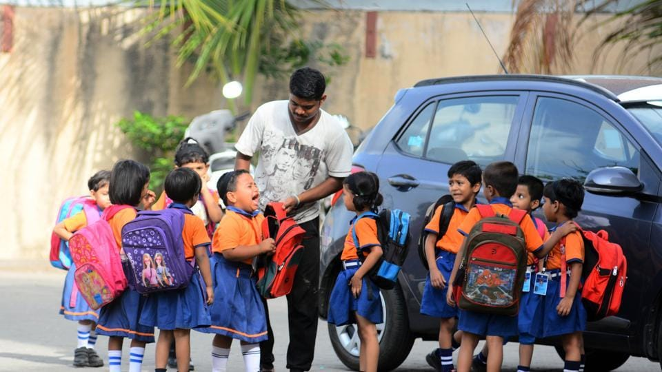 DAY ONE JITTERS: Students doing their best to cope on their first day at the Eon Gyanankur English school in the city on Friday. (Shankar Narayan/HT PHOTO)