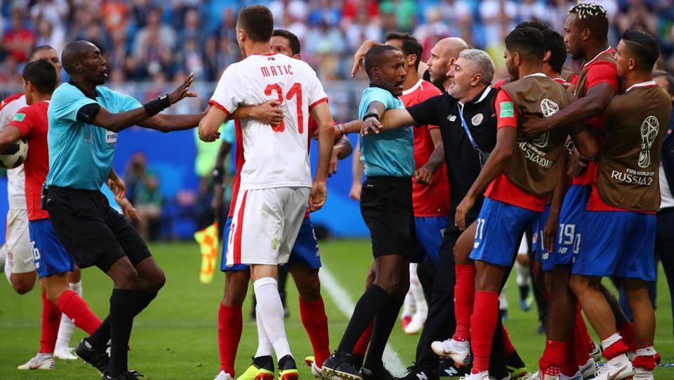 Serbia's Nemanja Matic is separated after clashing with Costa Rica assistant manager Luis Marin. (REUTERS)