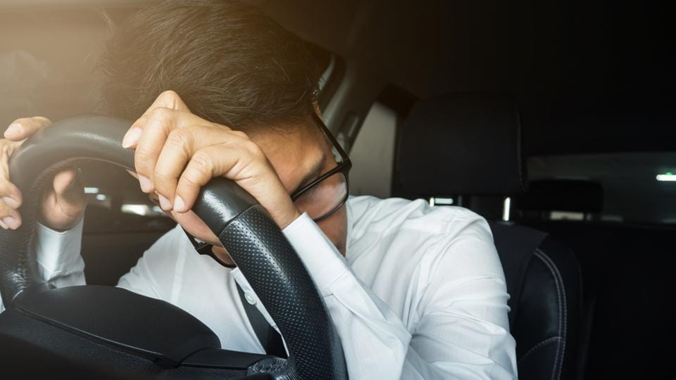 Snoozing behind the wheels? Here's how you can stay awake.