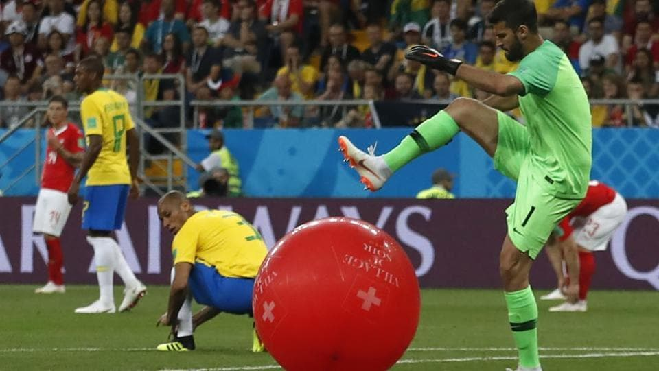Brazil goalkeeper Alisson, right, kicks a balloon during the group E match in the Rostov Arena. (AP)