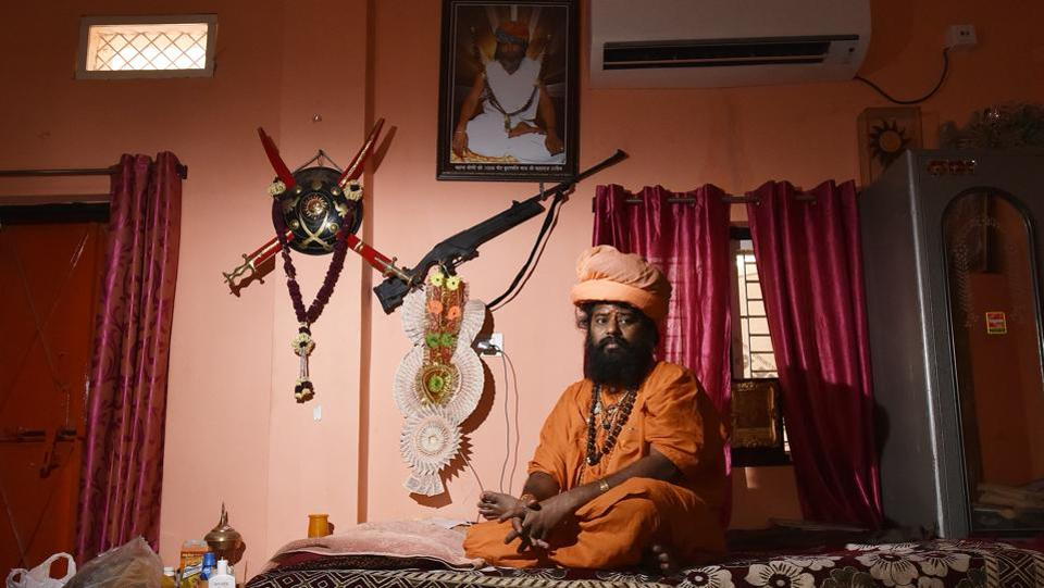 "Yogi Peer Ramnath, head of a 20-acre temple compound said he started a group called Hindu Vahini, ""which will defend any attack on the Hindu religion"". Another baba in Indore, Radhe Radhe Baba, who moved here from UP and now heads a temple complex, spends hours in his inner chamber, watching fairly unchanging CCTV footage of the complex and the streets outside. (Raj K Raj / HT Photo)"