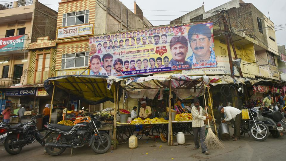 A banner advertises a religious gathering in Indore. In April this year, five godmen were offered minister-of-state-level berths in the state. Politicians in the state don't shy away from wearing their relationships with spiritual leaders on their sleeves. It is an accepted culture, said Rasheed Kidwai, writer, political author and visiting fellow at Observer Research Foundation. (Raj K Raj / HT Photo)