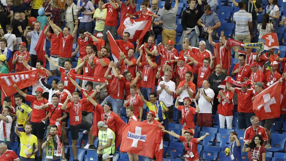 Swishers fans celebrate after the group E match between Brazil and Switzerland. (AP)