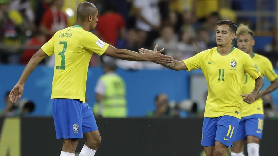 Brazil's Philippe Coutinho, right, is greeted by teammates Miranda after scoring his side's first goal against Switzerland. (AP)