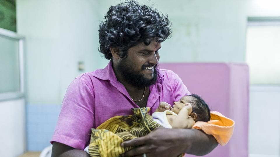 A look of joy breaks on to 28-year-old Senthil Kumar's face as he interacts with his two day old child at the Government General Hospital in Chrompet, Chennai on June 12, 2018. Heading into delivery rooms and care facilities for newborns, this series of images from UNICEF highlights the importance of early father-child bonding. (Prashanth Vishwanathan / UNICEF)