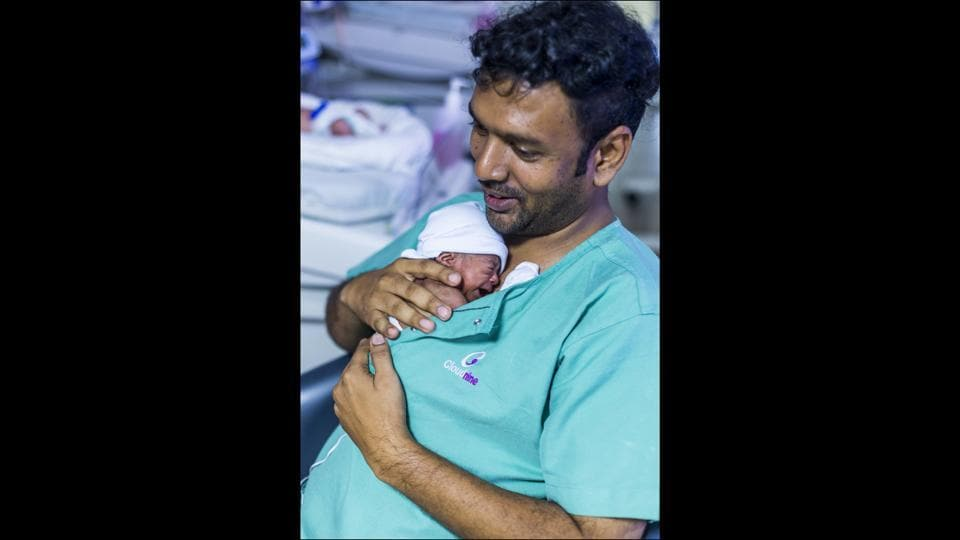 "38-year-old R Sudhan provides Kangaroo Care to his thirty-six days old child in the Neo Natal Intensive Care Unit of Cloud Nine Maternity Hospital, in Chennai. ""Evidence suggests that when fathers bond with their babies from the beginning of life, they are more likely to play a more active role in their child's development,"" UNICEF explains in a statement. (Prashanth Vishwanathan / UNICEF)"