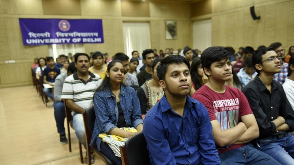The highest cutoff at Delhi University in the first list is 98.75% at Lady Shri Ram College for BA (Programme).