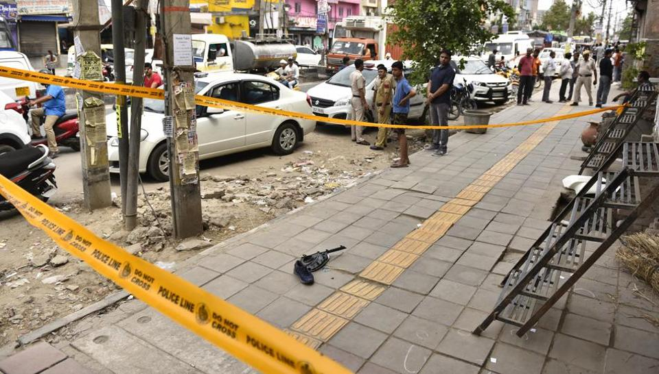 Police cordoned off the scene where two criminal gangs opened fire at each other in North Delhi's Burari area in New Delhi, June 18, 2018.