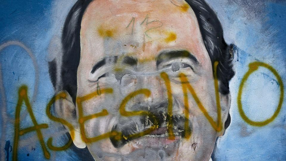 "The Spanish word for ""Murderer"" covers a mural of President Daniel Ortega. Ortega and his wife returned to power in 2007, and to many Nicaraguans it seemed their election campaign never stopped, even growing in size and intensity as they planted billboard portraits and other ostentatious works across the country. (Esteban Felix / AP)"