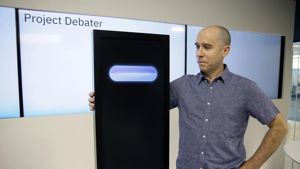 Dr. Noam Slonim, principal investigator, stands with the IBM Project Debater before a debate between the computer and two human debaters Monday, June 18, 2018, in San Francisco.