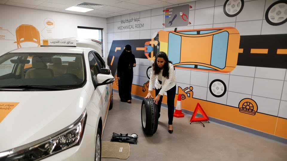 Maria al-Faraj practices how to adjust a tire during a lesson at the Driving Center. About 200 women are taking advantage of a company offer to teach female employees and their families at its driving academy in Dhahran to support the social revolution sweeping the kingdom. (Ahmed Jadallah / REUTERS)