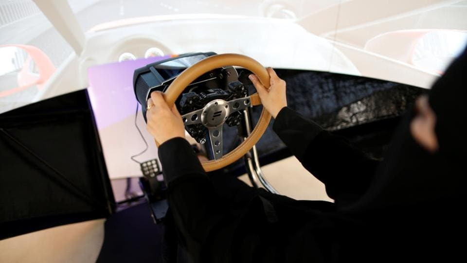 Amira Abdulgader practices on a simulator car. Many young Saudis regard Mohammed bin Salman's ascent to power as proof that their generation is finally getting a share of control over a country whose patriarchal traditions have for decades made power the province of old men. (Ahmed Jadallah / REUTERS)