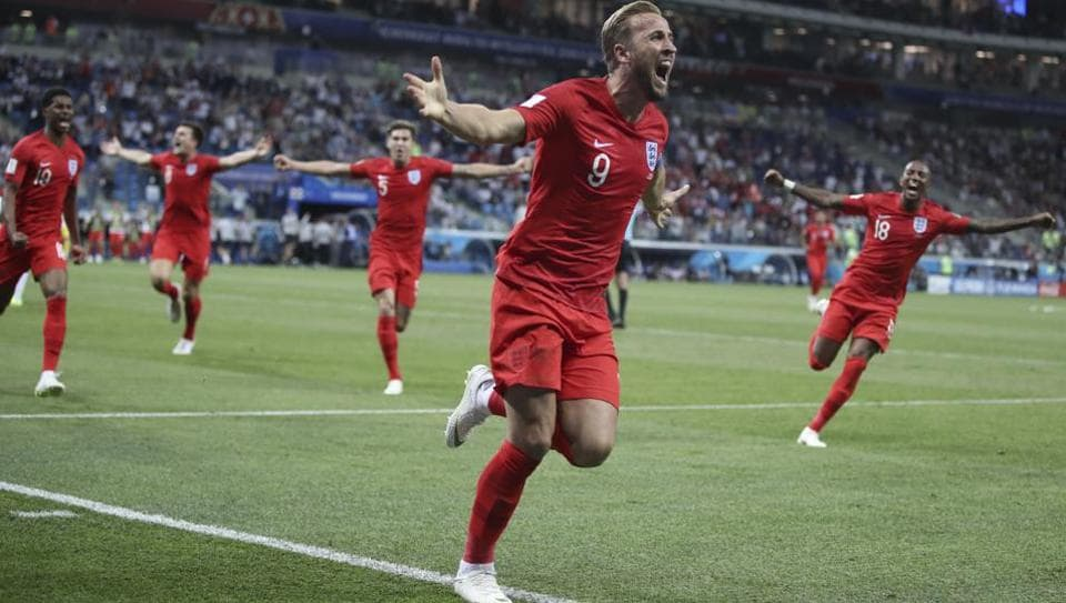 England's Harry Kane (C) celebrates after scoring during the group G match between Tunisia and England at the 2018 FIFA World Cup in the Volgograd Arena in Volgograd, Russia on June 18, 2018.  (AP)