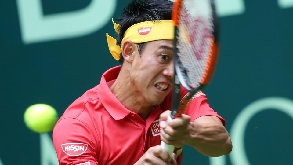 Kei Nishikori returns the ball to Germany's Matthias Bachinger during their match at the Halle Open tennis tournament.