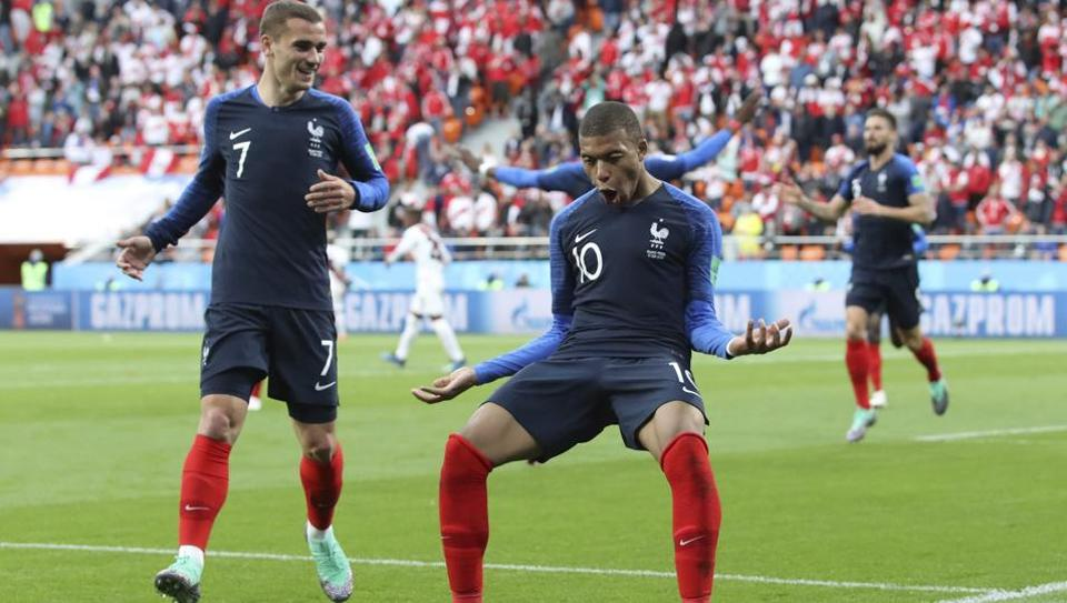 France's Kylian Mbappe(L) celebrates with teammate Antoine Griezmann after scoring the opening goal of the Group C game vs Peru at the 2018 FIFA World Cup in the Yekaterinburg Arena on Thursday.