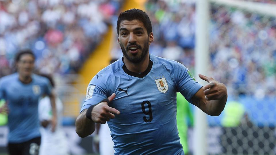 Luis Suarez scored a goal in his 100th international appearance for Uruguay as he helped them enter the round of 16 with a wonderful 1-0 win over Saudi Arabia.  (AFP)