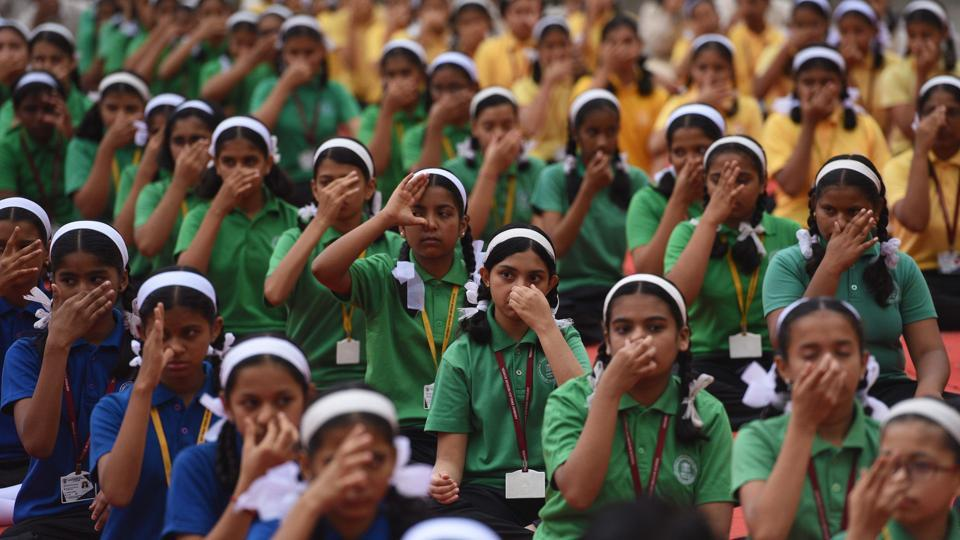 Students of Abhinav English Medium School, Ambegaon, perform a breathing exercise during the yoga session organised on the occasion of International Day of Yoga. Puneites from all walks of life were part of the celebrations as various institutions and organisations practised yoga for a healthier life. (Pratham Gokhale/HT Photo)
