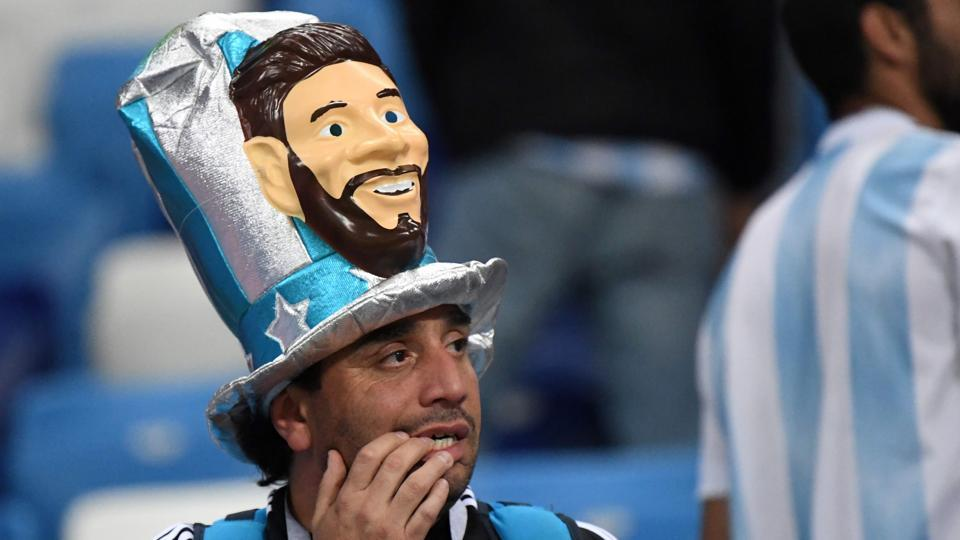 An Argentina's fan wearing a fancy hat depicting Lionel Messi reacts after his team lost to Croatia in a FIFA World Cup 2018 match at the Nizhny Novgorod Stadium. (AFP)