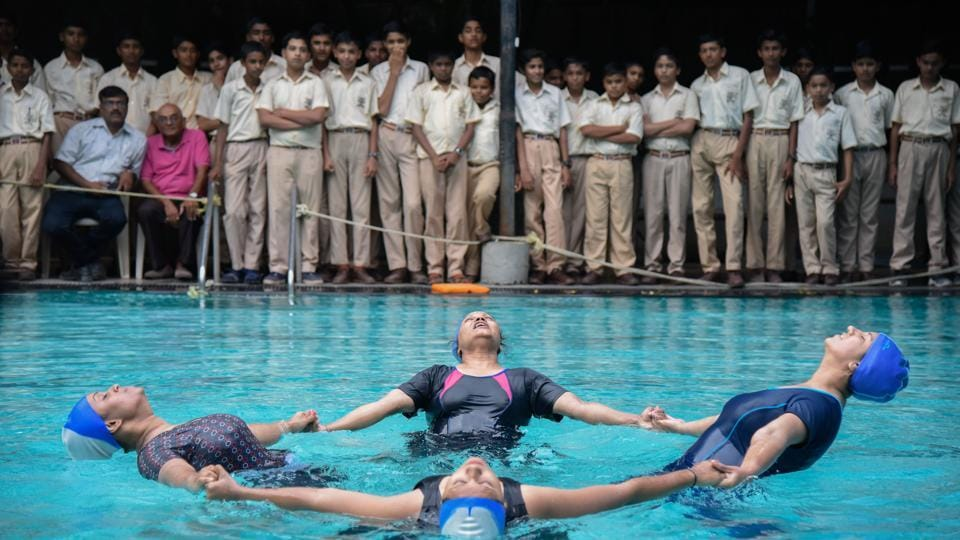 AQUA ASANA: Women from the Institute of yoga in Pune perform aqua yoga at Nande swimming pool at Balgandharva Rang Mandir on Wednesday. The event was organised by Dhyanyog Seva trust on the eve of International Yoga Day (Sanket Wankhade/HT PHOTO)