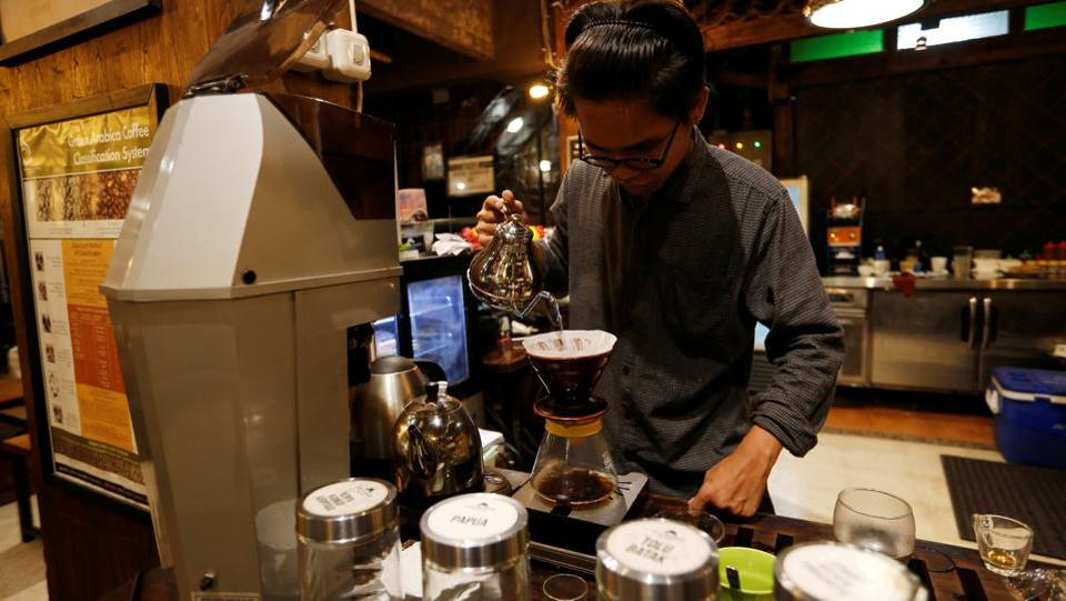 A barista brews locally gown coffee at Jack Runner Roastery coffee shop. The arabica grown in Sumatra is unique, in part due to the unusual bean drying process employed there. Farmers in other countries tried replicating the process but results turned to be unreliable. (Willy Kurniawan / REUTERS)