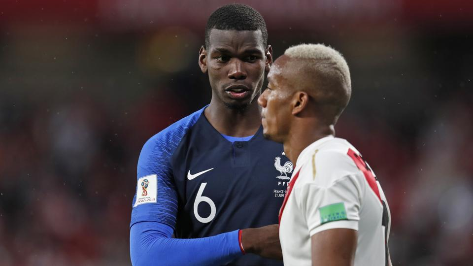 France's Paul Pogba comforts Peru's Luis Advincula at the end of the Group C match. (AP)