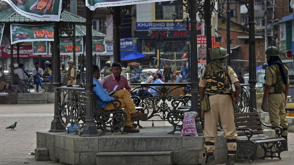 Security personnel stand guard at Lal Chowk in Srinagar on Tuesday after the BJP decided to pull out of its ruling alliance with the PDP in Jammu and Kashmir.
