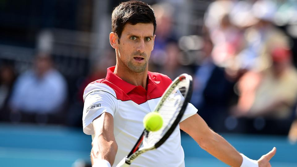 Novak Djokovic returns against Bulgaria's Grigor Dimitrov during their Queen's Club Championships match on Thursday.
