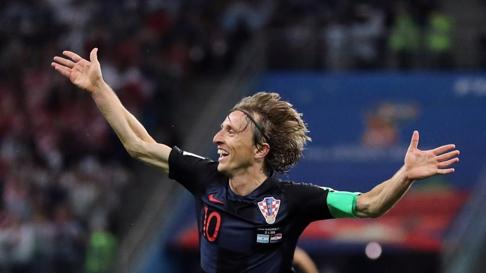 Luka Modric received the ball outside the Argentina penalty area, and composed himself before unleashing a curling effort to score the goal of the match. (REUTERS)