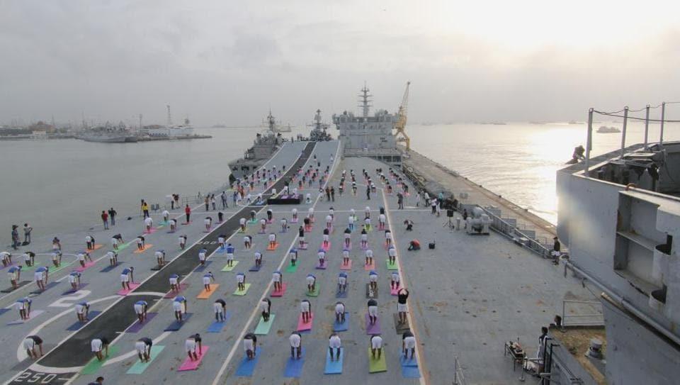 Indian Naval Cadets perform yoga on the deck of INS Virat to mark the fourth International Yoga Day in Mumbai, Maharashtra on June 21, 2018. (Bhushan Koyande / HT Photo)