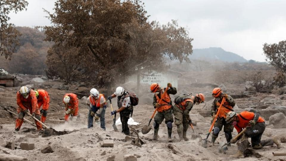 Mexican volunteer rescue workers search the house of one of Garcia's missing sisters in an area affected by the volcano. But the Guatemalan rescue workers only searched during the first three days after the tragedy, calling off efforts as the volcano continued to rumble. (Carlos Jasso / REUTERS)