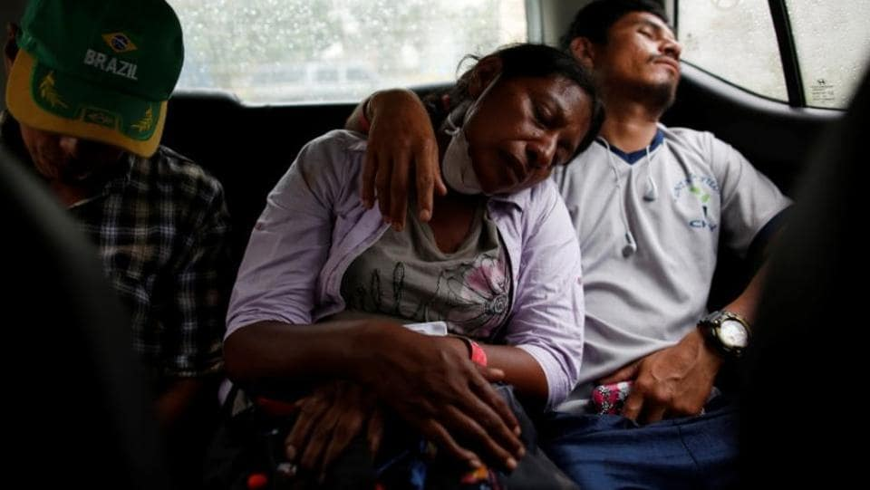 Garcia sleeps next to her partner, Fito Perez, after searching for her family in the homes buried by ash. In the early days after the eruption, Garcia thought she had lost all her six children. (Carlos Jasso / REUTERS)