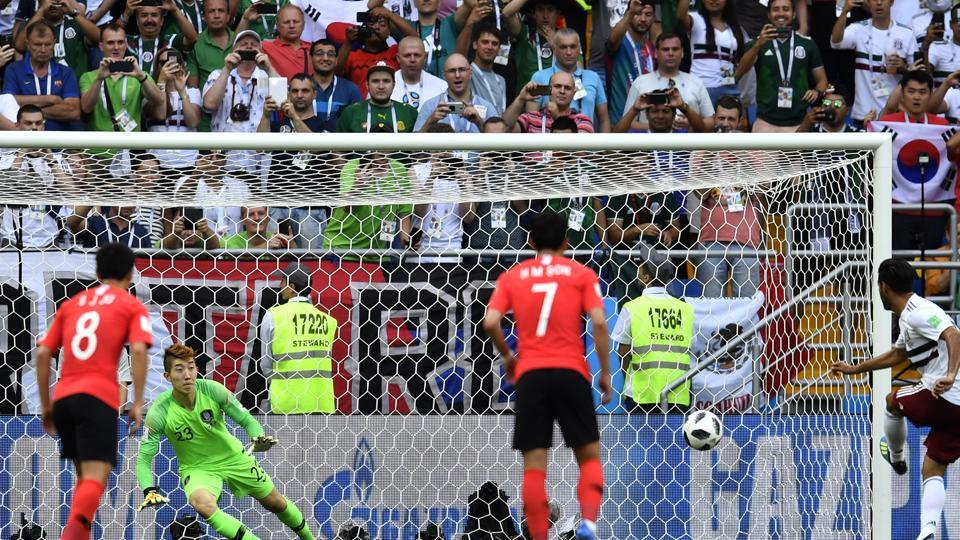 Mexico's Carlos Vela, right, scores his side's opening goal from a penalty kick during the group F match between Mexico and South Korea at the 2018 soccer World Cup. (AP)