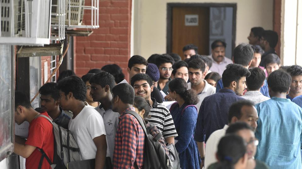 Delhi university aspirants standing in long queues to get admission for the new academic session 2018-19 at Hindu College in New Delhi  on June 19, 2018.