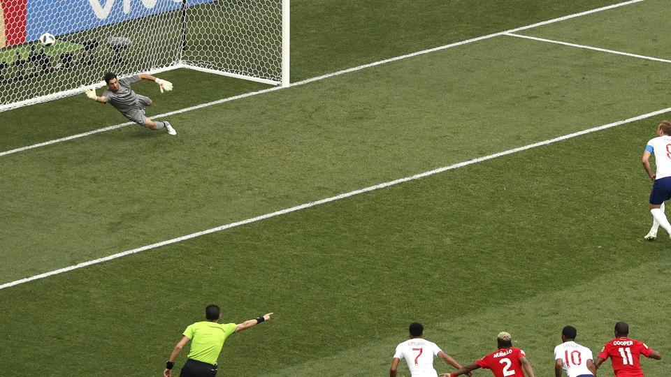 England's Harry Kane, top right, scores past Panama goalkeeper Jaime Penedo, his first penalty during the group G match between England and Panama. (AP)