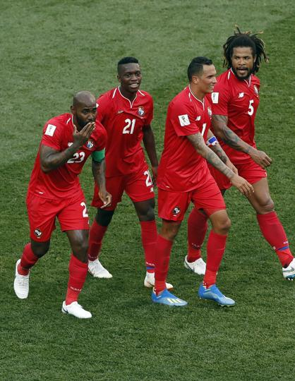 Panama' Felipe Baloy, left, celebrate with teammates after scoring his site's first goal. (AP)