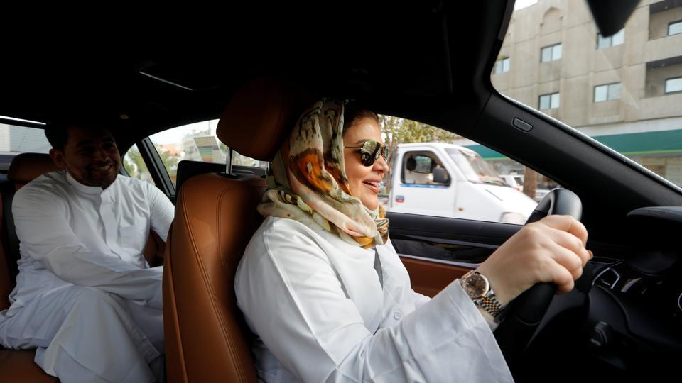 Samira al-Ghamdi, a practicing psychologist drives to work with her son Abdulmalik, 26, in Jeddah, Saudi Arabia. Saudi women steered their cars through busy streets for the first time on Sunday after the world's last remaining ban on women driving was lifted. (Zohra Bensemra / REUTERS)