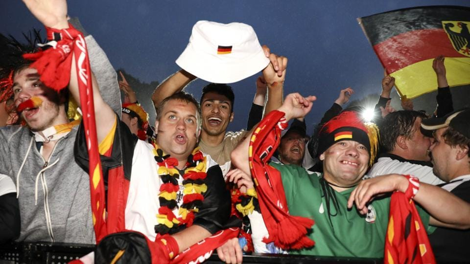 Germany fans react as they watch the match at public viewing area at Brandenburg Gate.  (REUTERS)