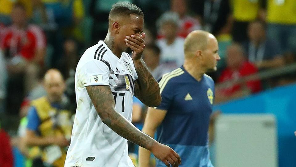 Germany's Jerome Boateng walks off the pitch after he was shown a red card by referee Szymon Marciniak.  (REUTERS)