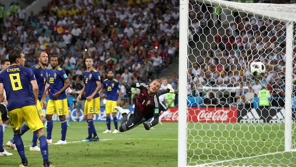 Germany's Toni Kroos scores their second goal past Sweden's Robin Olsen.  (REUTERS)