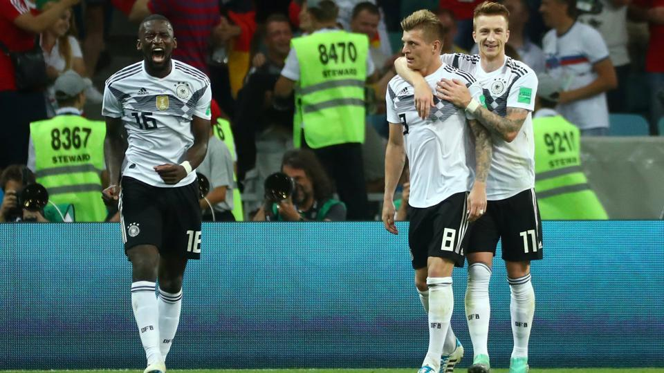 Germany's Toni Kroos (C) celebrates scoring their second goal with Marco Reus (R) and Antonio Rudiger (L).  (REUTERS)