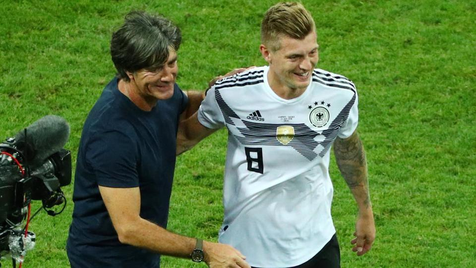 Germany coach Joachim Low and Toni Kroos celebrate after the match.  (REUTERS)