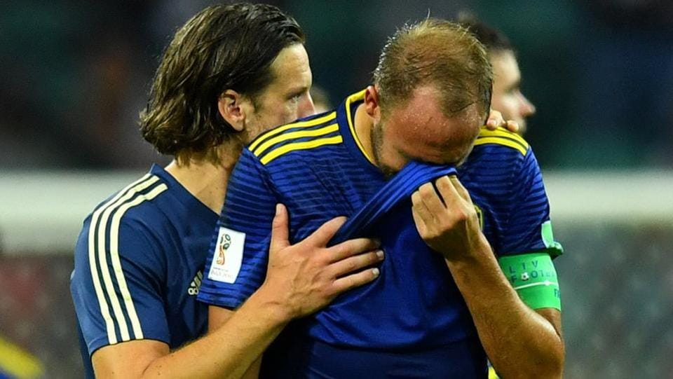 Sweden's Andreas Granqvist looks dejected after the match.  (REUTERS)
