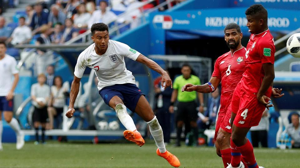 England's Jesse Lingard scores their third goal. (REUTERS)