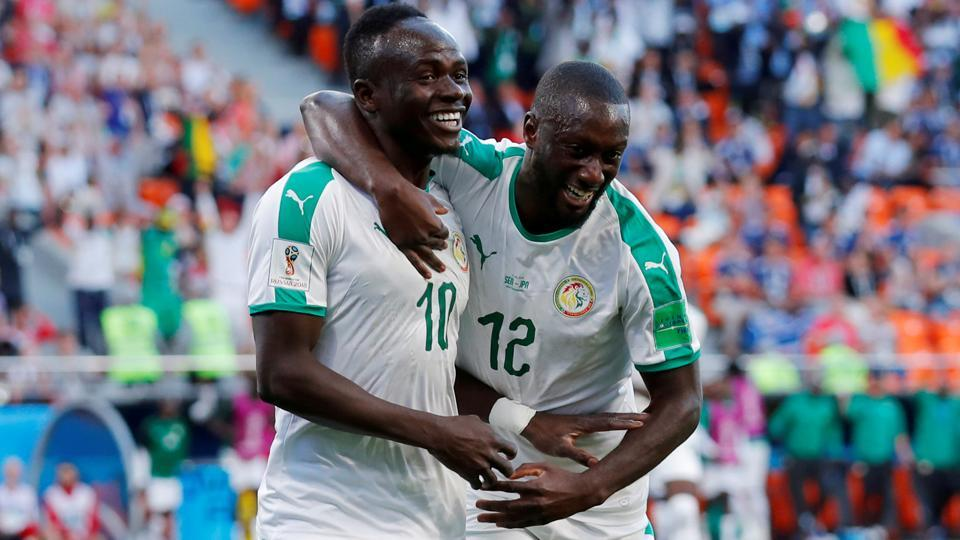 Senegal's Sadio Mane celebrates with Youssouf Sabaly after scoring their first goal.  (REUTERS)