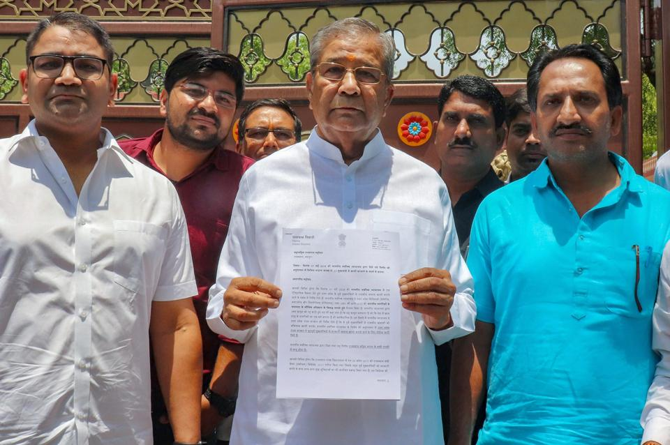 "Rajasthan MLA Ghanshyam Tiwari (C) resigned from the BJP on Monday, accusing chief minister Vasundhara Raje of corruption and nepotism. His resignation letter to BJP president Amit Shah said, ""The chief of state government in Rajasthan in collusion with some ministers and bureaucrats has been robbing the state and the level of corruption has scaled a new high."" Tiwari also accused Shah of inaction and having surrendered to corruption. (PTI)"