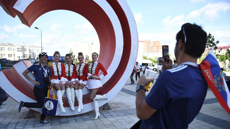 A Japan fan poses outside the Ekaterinburg Arena.  (AFP)