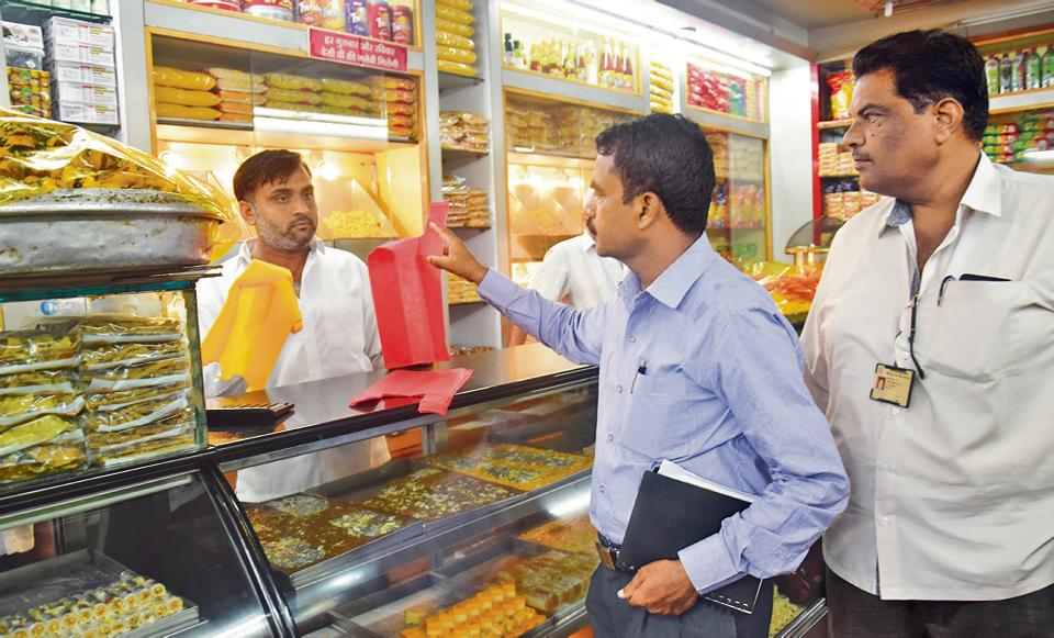 Municipal officials conduct a check-up at a sweet mart in Nigdi on Monday.