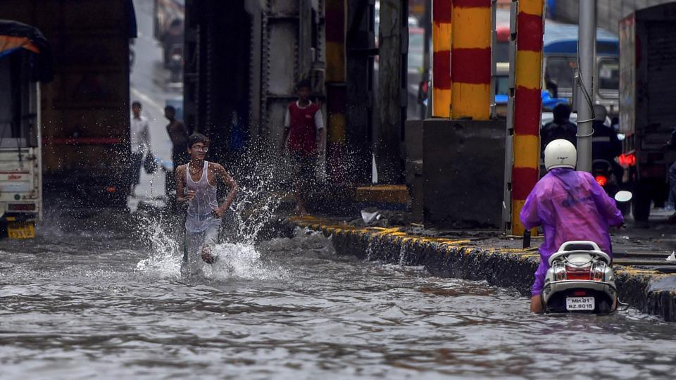 Rain continued to batter Mumbai, killing four people in 24 hours in the city and Thane district. Several areas witnessed traffic snarls and waterlogging which affected local train services. Kolkata and its neighbouring districts of Howrah, Hooghly, Nadia, North and South 24 Parganas were also lashed by torrential rains on Monday morning. (Shashank Parade / PTI)
