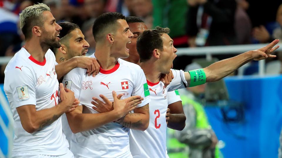 Switzerland's Granit Xhaka (centre) celebrates scoring against Serbia at the FIFA World Cup 2018.