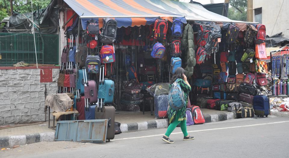 A shopkeeper encroaches a footpath near Lansdowne Chowk in Dehradun.